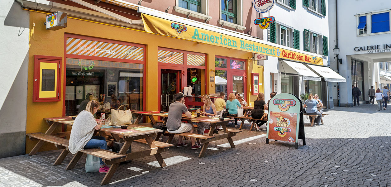 Enjoy real American food & drinks on the Papa Joe`s terrace - on the ground floor of Hotel California.